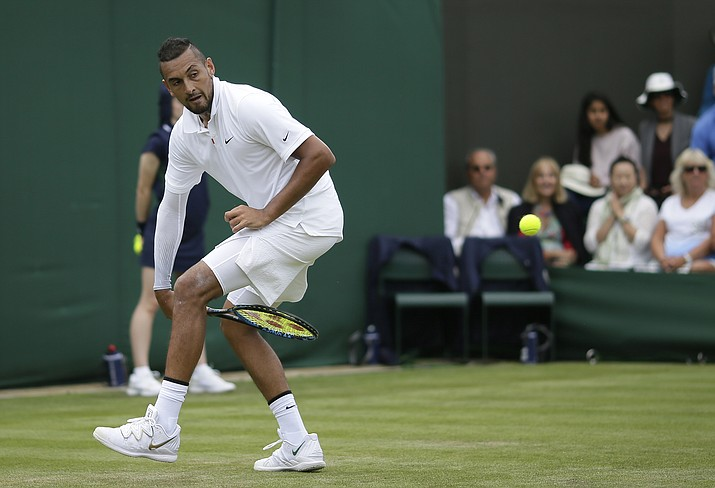 Australia's Nick Kyrgios returns the ball from between his legs to Australia's Jordan Thompson in a Men's singles match during day two of the Wimbledon Tennis Championships in London, Tuesday, July 2, 2019. (Tim Ireland/AP)