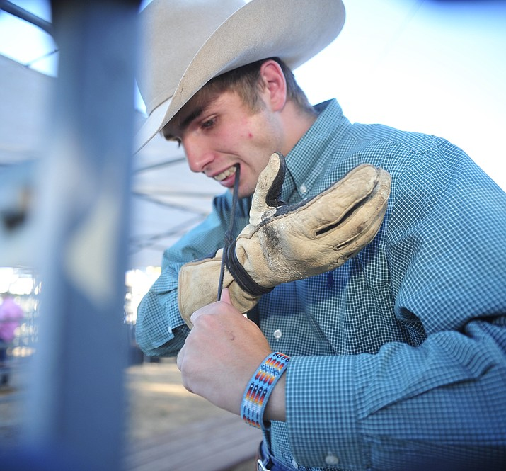 JC Mortensen, grandson of PRCA Hall of Fame and Prescott Frontier Days General Manager J.C. Trujillo gets ready for his out in the bull riding at the World's Oldest Rodeo on Tuesday, July 2, at the Prescott Rodeo grounds. (Les Stukenberg/Courier)