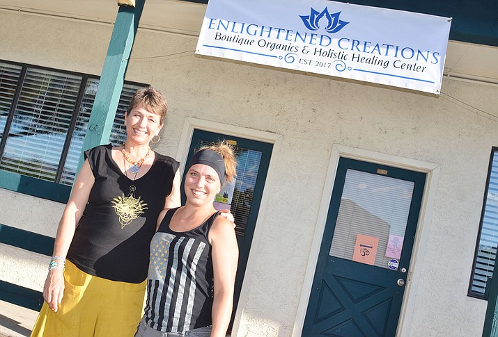 Nanaiya Craft, left, owner of the Enlightened Creations Boutique Organics and Holistic Healing Center, and manager Alyssa Hill pose in front of the newly opened business in Cottonwood on Monday.  Submitted photo