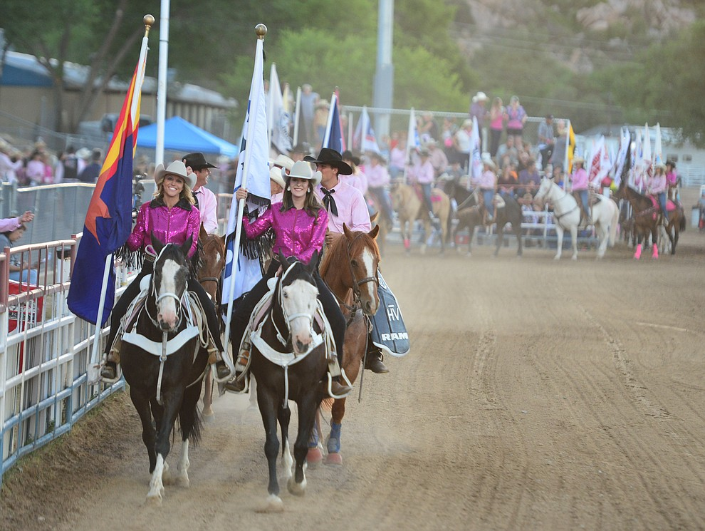 The grand entry enters the arena to open the second performance of the Prescott Frontier Days Rodeo Tuesday July 2, 2019.  (Les Stukenberg/Courier)