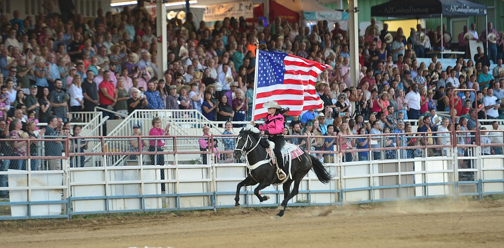 The American flag is presented during the second performance of the Prescott Frontier Days Rodeo Tuesday July 2, 2019.  (Les Stukenberg/Courier)