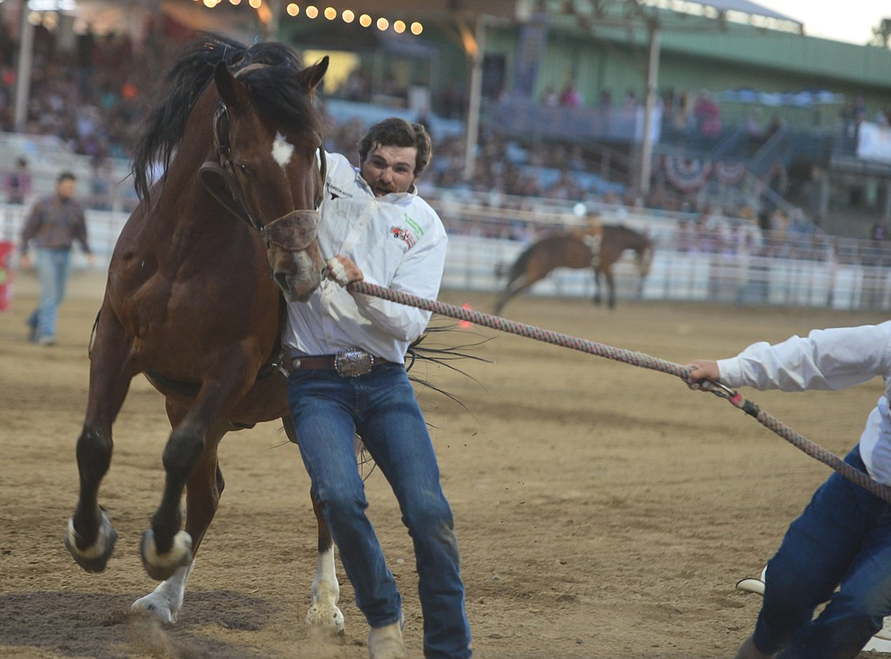Wild horse racing during the second performance of the Prescott Frontier Days Rodeo Tuesday July 2, 2019.  (Les Stukenberg/Courier)