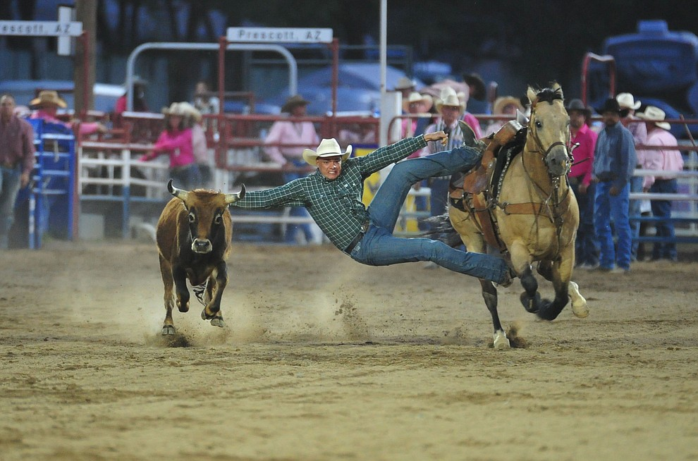 Chance Honey grabs too big of a reach in the steer wrestling during the second performance of the Prescott Frontier Days Rodeo Tuesday July 2, 2019.  (Les Stukenberg/Courier)
