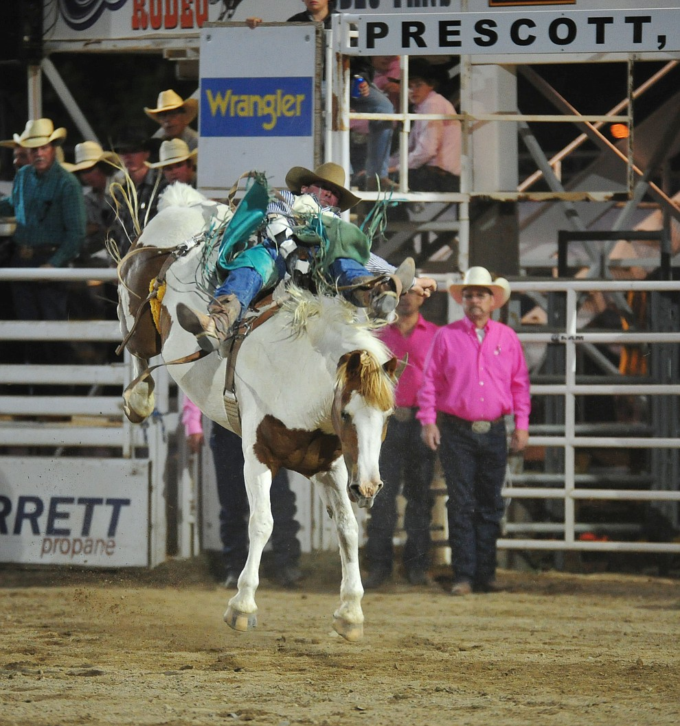 Zach Hibler on Little Linda in the bareback riding during the second performance of the Prescott Frontier Days Rodeo Tuesday July 2, 2019.  (Les Stukenberg/Courier)