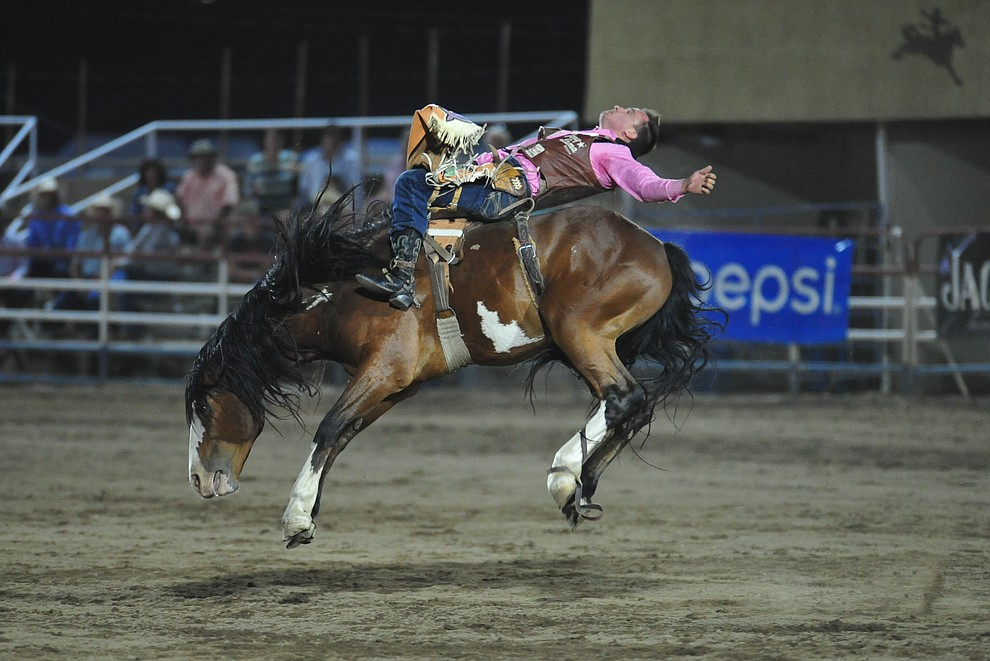 Jake Brown on Saguaro in the bareback riding during the second performance of the Prescott Frontier Days Rodeo Tuesday July 2, 2019.  (Les Stukenberg/Courier)