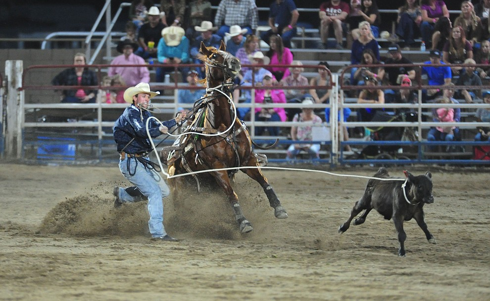 Stran Thompson in the tie down roping during the second performance of the Prescott Frontier Days Rodeo Tuesday July 2, 2019.  (Les Stukenberg/Courier)