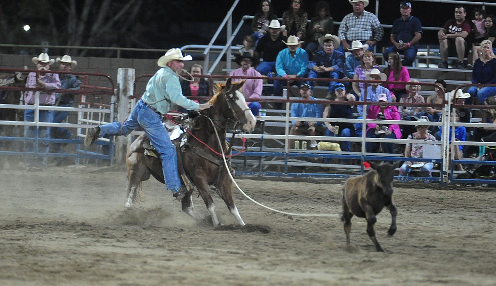 Travis Lewis in the tie down roping during the second performance of the Prescott Frontier Days Rodeo Tuesday July 2, 2019.  (Les Stukenberg/Courier)