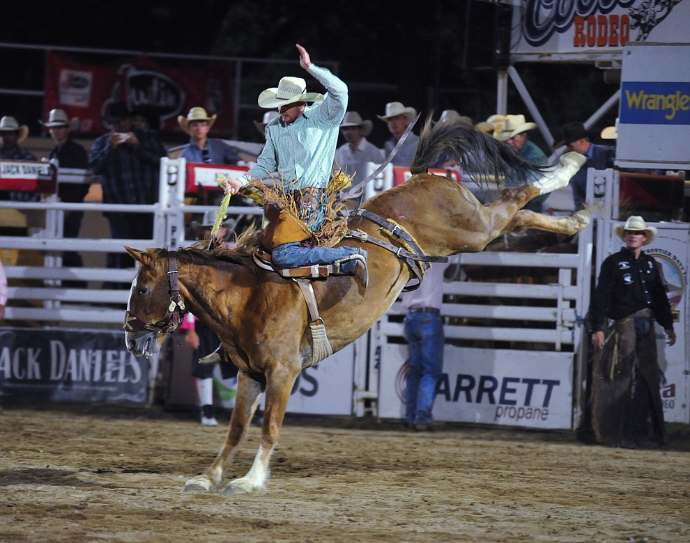 Cody Ballard on Snort in the saddle bronc riding during the second performance of the Prescott Frontier Days Rodeo Tuesday July 2, 2019.  (Les Stukenberg/Courier)