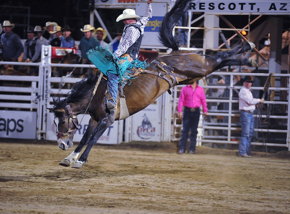 Taos Muncy scored 87 on High Loonesome in the saddle bronc riding during the second performance of the Prescott Frontier Days Rodeo Tuesday July 2, 2019.  (Les Stukenberg/Courier)