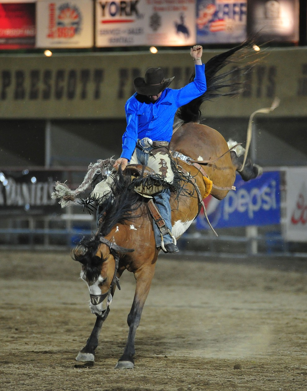 Cooper Thatcher on Baby Face in the saddle bronc riding during the second performance of the Prescott Frontier Days Rodeo Tuesday July 2, 2019.  (Les Stukenberg/Courier)