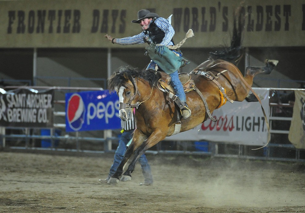 Tom Webster on Moon Valley in the saddle bronc riding during the second performance of the Prescott Frontier Days Rodeo Tuesday July 2, 2019.  (Les Stukenberg/Courier)