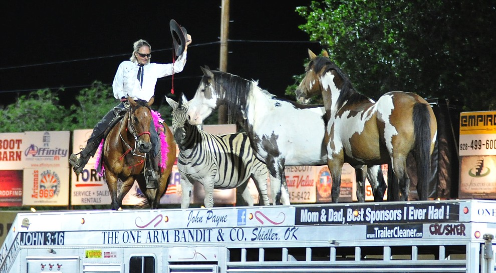"""John Payne """"The One Armed Bandit"""" entertains the crowd during the second performance of the Prescott Frontier Days Rodeo Tuesday July 2, 2019.  (Les Stukenberg/Courier)"""