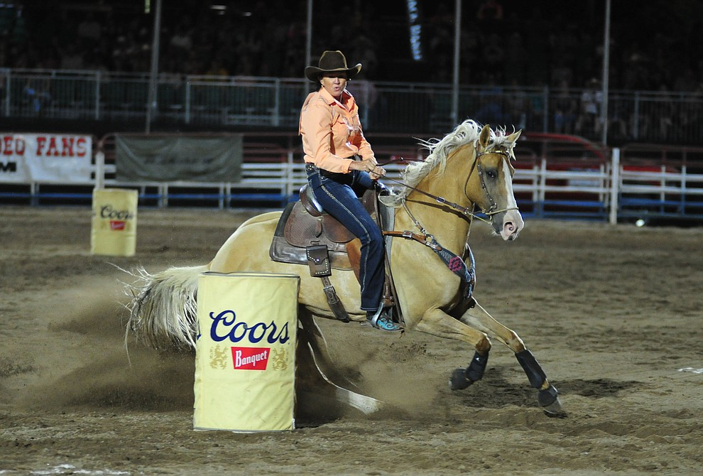 Debbie Carter runs an 18.63 in the barrel race during the second performance of the Prescott Frontier Days Rodeo Tuesday July 2, 2019.  (Les Stukenberg/Courier)