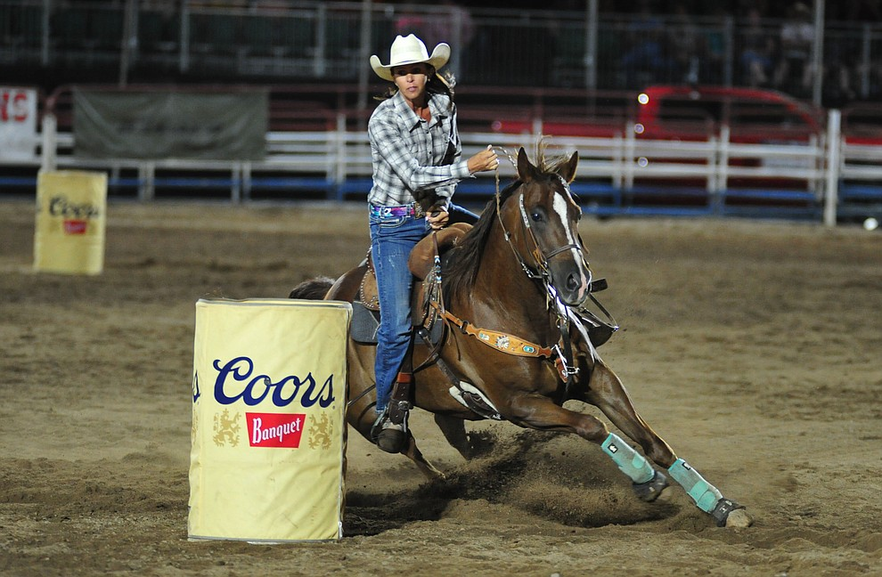 Jackie Crane in the barrel race during the second performance of the Prescott Frontier Days Rodeo Tuesday July 2, 2019.  (Les Stukenberg/Courier)