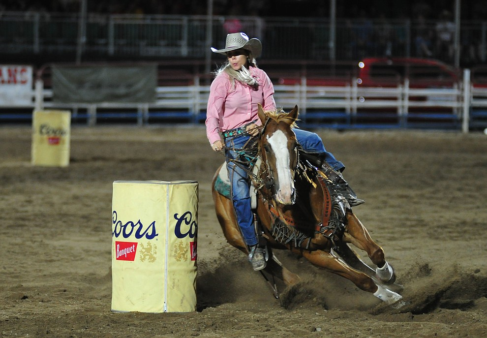 Tarryn Lee has an 18 second run in the barrel race during the second performance of the Prescott Frontier Days Rodeo Tuesday July 2, 2019.  (Les Stukenberg/Courier)