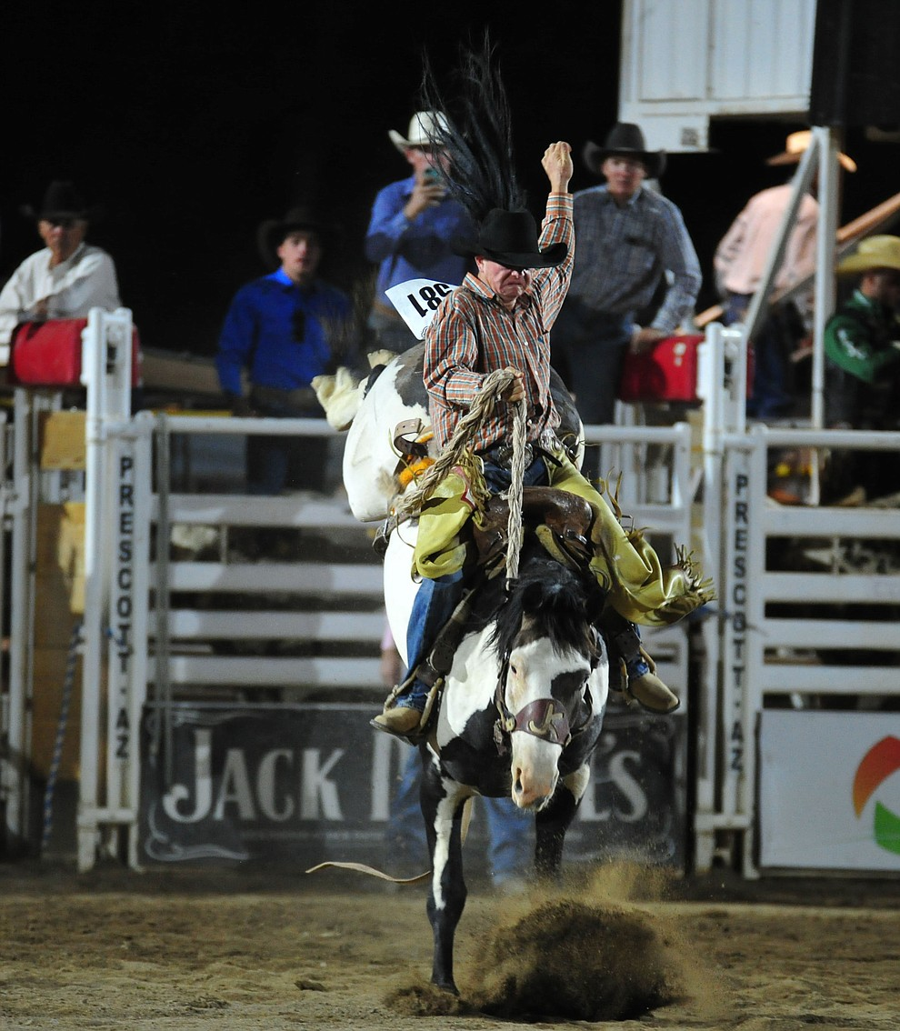 Tommy Kerr score a 71 on his reride in the saddle bronc riding during the second performance of the Prescott Frontier Days Rodeo Tuesday July 2, 2019.  (Les Stukenberg/Courier)