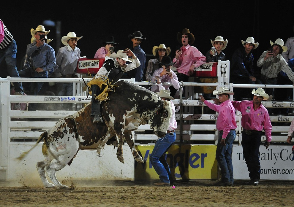 JC Mortenson on Bank Roll in the bull riding during the second performance of the Prescott Frontier Days Rodeo Tuesday July 2, 2019.  (Les Stukenberg/Courier)
