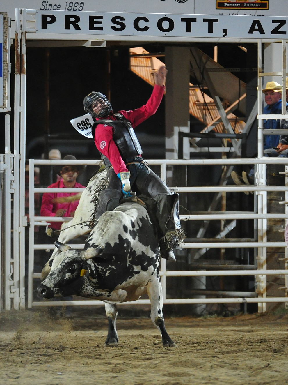 Tyler Bingham on Nitro Fusion in the bull riding during the second performance of the Prescott Frontier Days Rodeo Tuesday July 2, 2019.  (Les Stukenberg/Courier)