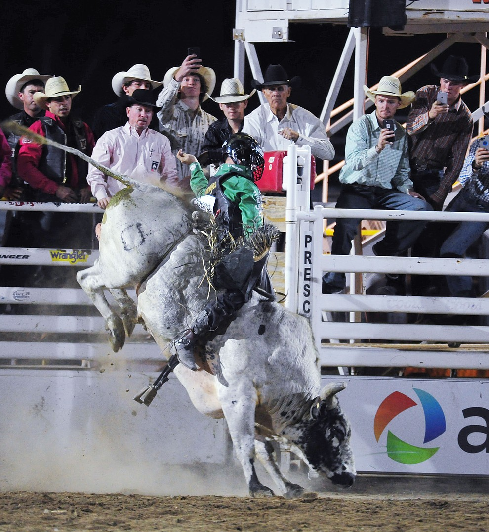 Sage Kimzey on Wild n Free in the bull riding during the second performance of the Prescott Frontier Days Rodeo Tuesday July 2, 2019.  (Les Stukenberg/Courier)