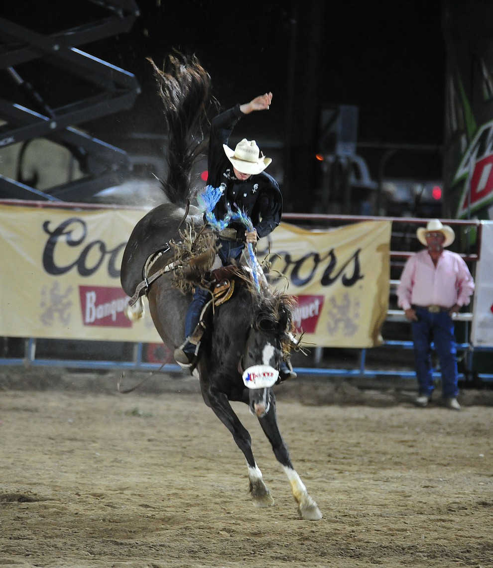 Ross Griffin score an 80 on his reride in the saddle bronc riding during the second performance of the Prescott Frontier Days Rodeo Tuesday July 2, 2019.  (Les Stukenberg/Courier)