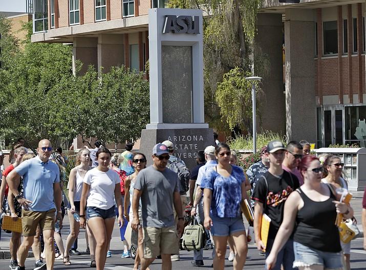 Pedestrians cross University Avenue in 2018 on the campus of Arizona State University in Tempe. (Matt York/AP, file)