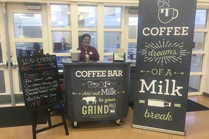 This Feb. 22, 2018 photo provided by Orange County Public Schools shows a coffee stand at Cypres Creek High School in Orlando, Florida. Orange County schools did not receive dairy industry grants for the coffee bars, but the local dairy council provided chalkboard-style signs and menus. (Orange County Public Schools)