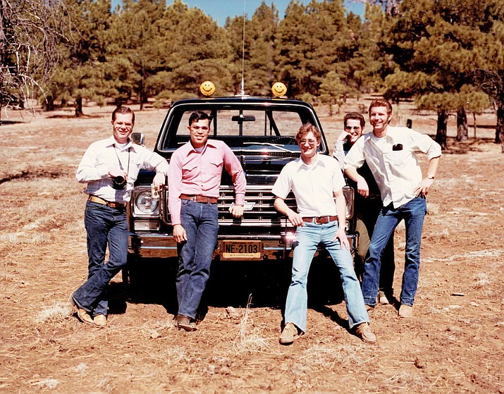 Pete Brown, Jon Stewart, Fred White, Bob DeLander and others strike a pose in front of a 1980s Chevrolet with KC lights. DeLander celebrated retirement from KC HiLiTES June 25. (Photo courtesy of the DeLander family)