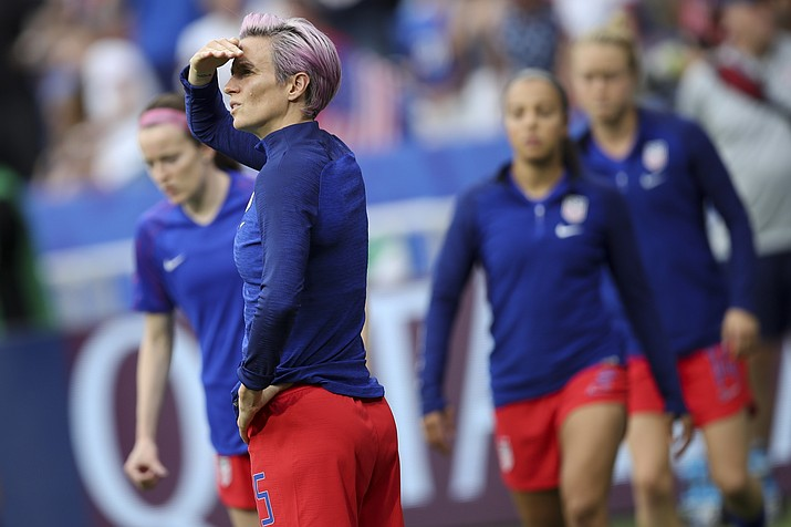 United States' Megan Rapinoe warms up before the Women's World Cup semifinal soccer match between England and the United States, at the Stade de Lyon outside Lyon, France, Tuesday, July 2, 2019. (Francisco Seco/AP)