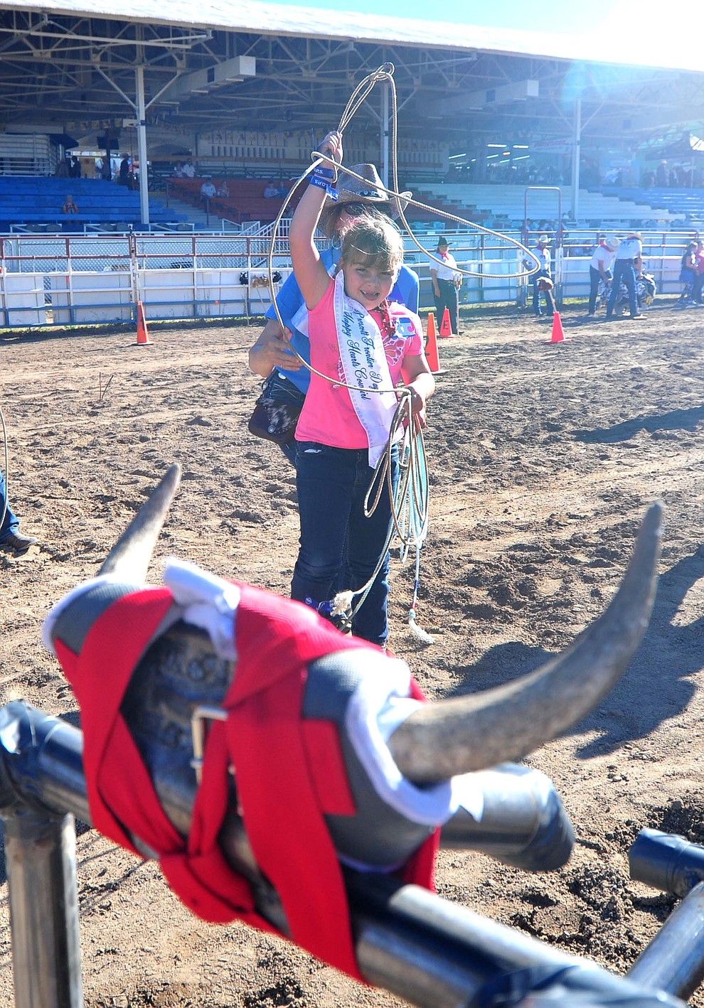 Six-year old Daisy Ellis ropes a steer during the annual Happy Hearts Rodeo for Exceptional Children at the Prescott Frontier Days Rodeo Monday July 1, 2019.  (Les Stukenberg/Courier)