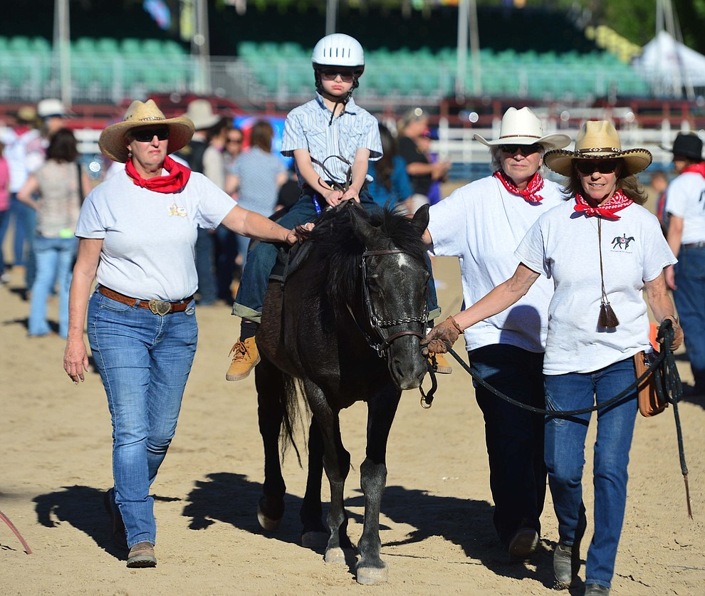 Morgan Devereux rides a horse with the Horses with Heart volunteers during the annual Happy Hearts Rodeo for Exceptional Children at the Prescott Frontier Days Rodeo Monday July 1, 2019.  (Les Stukenberg/Courier)