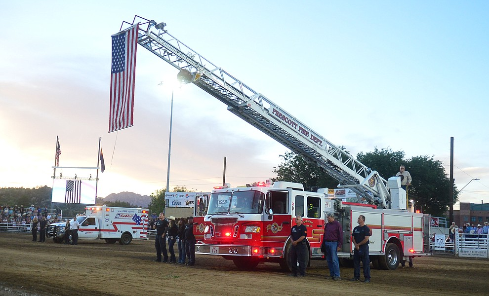 First responders from Prescott area agencies were honored during the third performance of the Prescott Frontier Days Rodeo Wednesday July 3, 2019.  (Les Stukenberg/Courier)