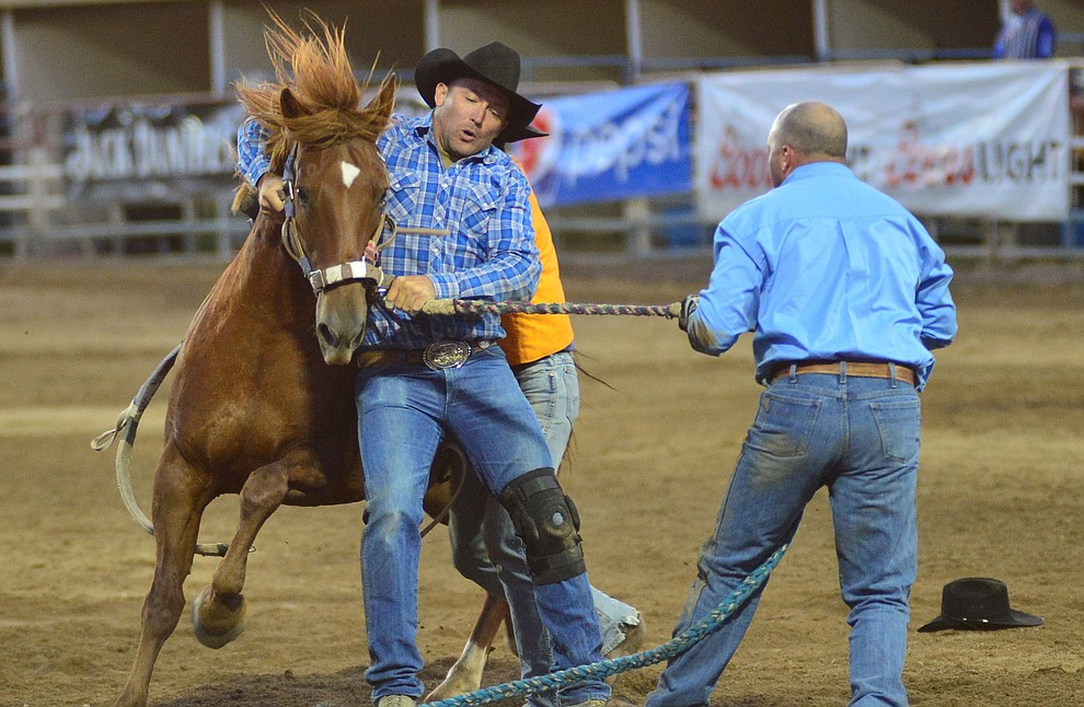 Wild Horse Race/Extreme Bronc riding action during the third performance of the Prescott Frontier Days Rodeo Wednesday July 3, 2019.  (Les Stukenberg/Courier)
