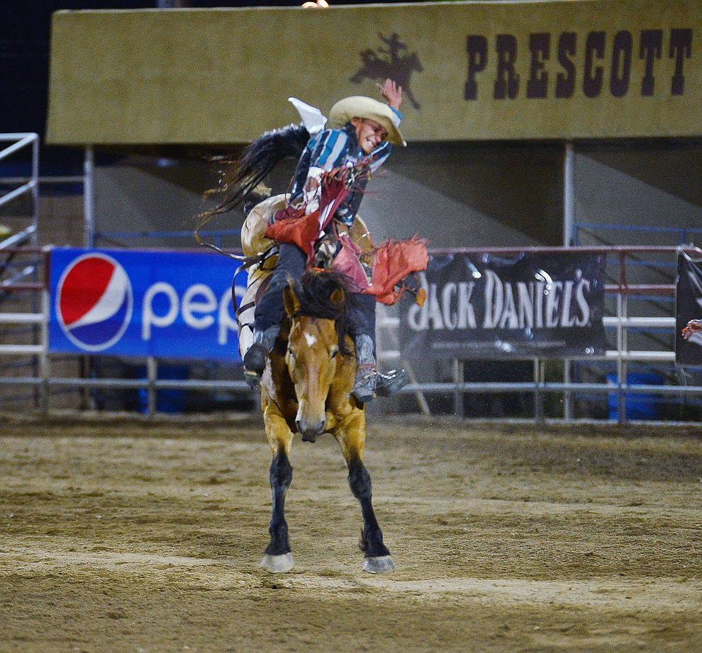 Earl Tsosie Jr. scores 68 on Happy Trails in the bareback riding during the third performance of the Prescott Frontier Days Rodeo Wednesday July 3, 2019.  (Les Stukenberg/Courier)