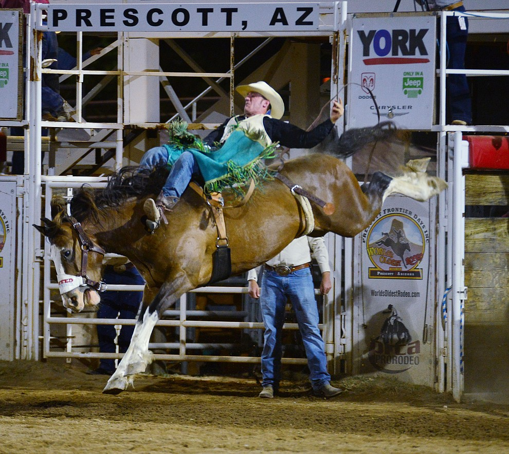 Wyatt Ortega on Pow Wow Nation in the bareback riding during the third performance of the Prescott Frontier Days Rodeo Wednesday July 3, 2019.  (Les Stukenberg/Courier)