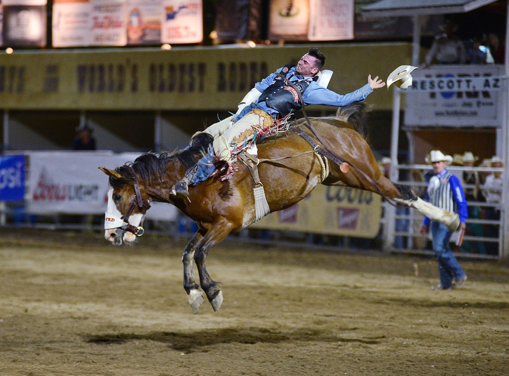 Logan Patterson scores 88 on Pow Wow Rocks to take the lead in the bareback riding during the third performance of the Prescott Frontier Days Rodeo Wednesday July 3, 2019.  (Les Stukenberg/Courier)