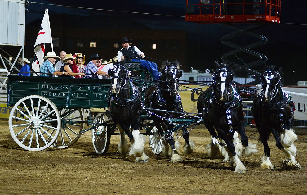The Diamond Z English Shire Horses show off for the crowd during the third performance of the Prescott Frontier Days Rodeo Wednesday July 3, 2019.  (Les Stukenberg/Courier)