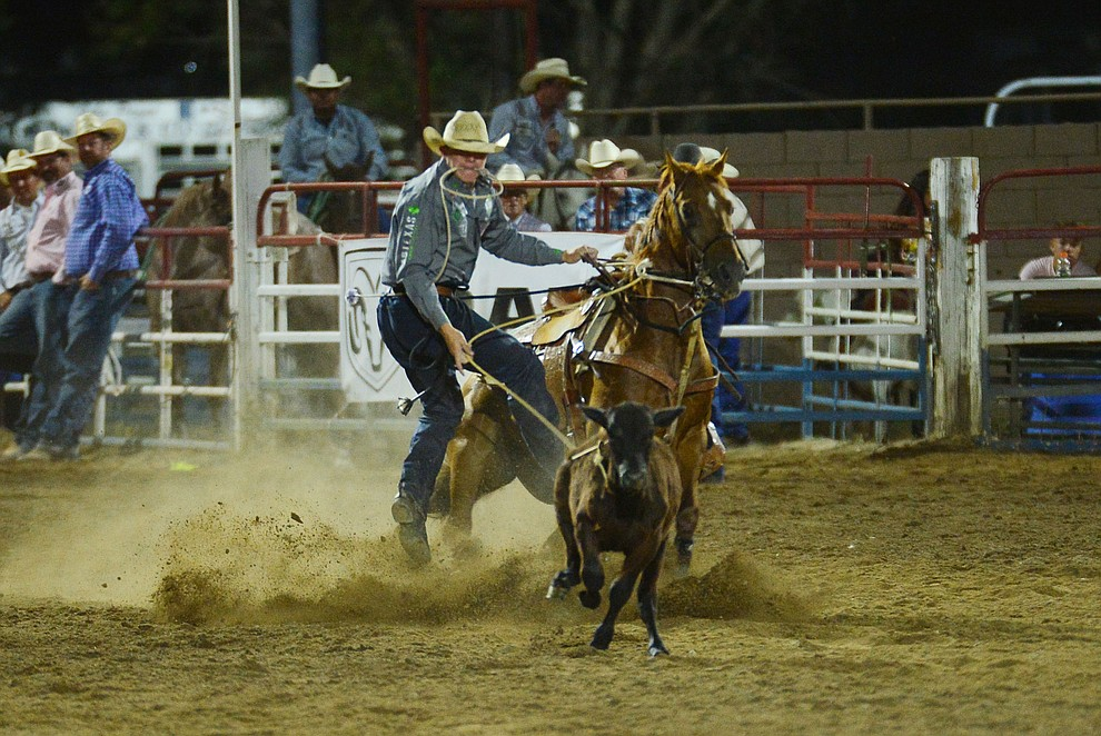 Marty Yates makes an 11.7 second run in the tie down roping during the third performance of the Prescott Frontier Days Rodeo Wednesday July 3, 2019.  (Les Stukenberg/Courier)