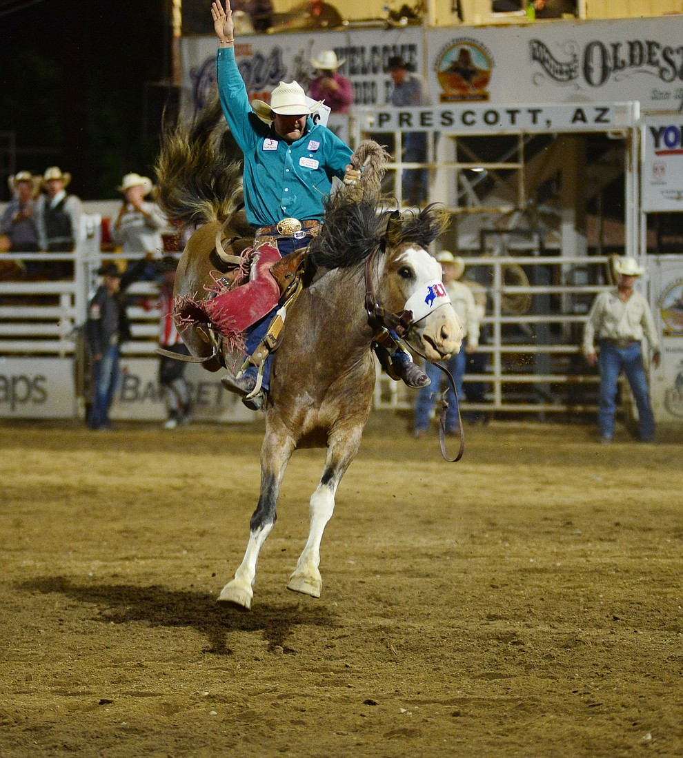 Cameron Messier on Raise Your Glass in the saddle bronc riding during the third performance of the Prescott Frontier Days Rodeo Wednesday July 3, 2019.  (Les Stukenberg/Courier)
