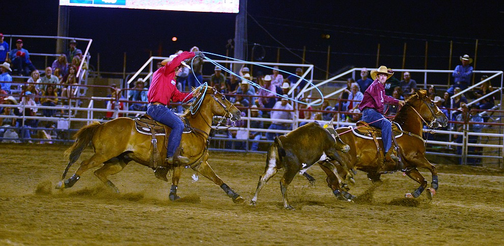 Buddy Hawkins and Tate Kirchenschlager make a 7.3 second run in the team roping during the third performance of the Prescott Frontier Days Rodeo Wednesday July 3, 2019.  (Les Stukenberg/Courier)