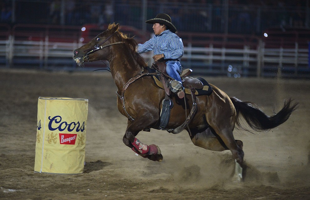 Autumnrain Chee makes a 17.95 second run in the barrel race during the third performance of the Prescott Frontier Days Rodeo Wednesday July 3, 2019.  (Les Stukenberg/Courier)