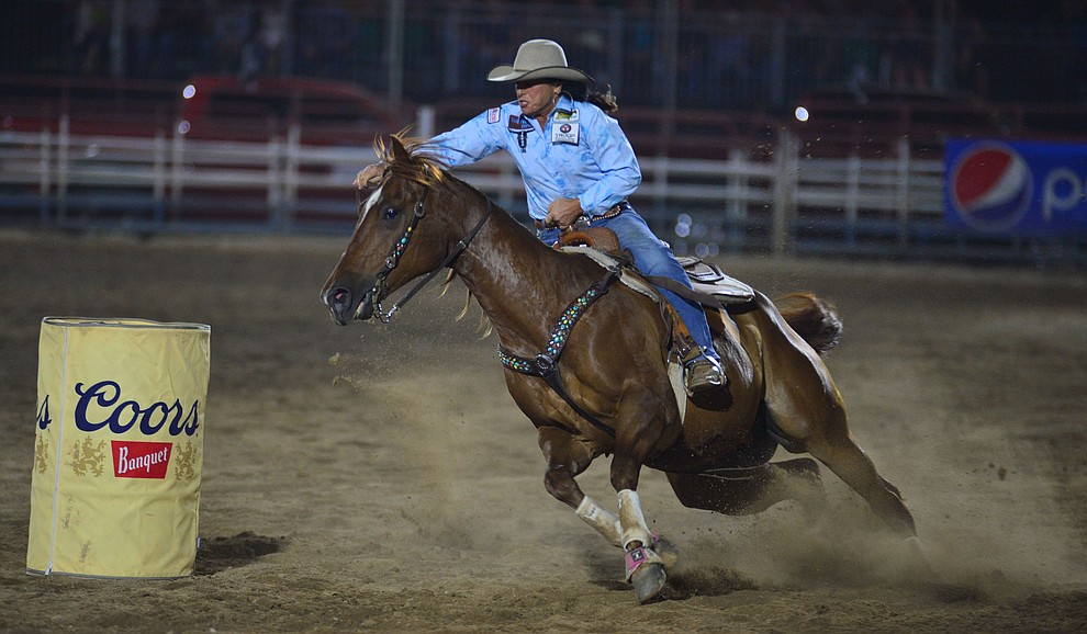Mary Jo Camera makes a 17.76 second run in the barrel race to take the lead during the third performance of the Prescott Frontier Days Rodeo Wednesday July 3, 2019.  (Les Stukenberg/Courier)