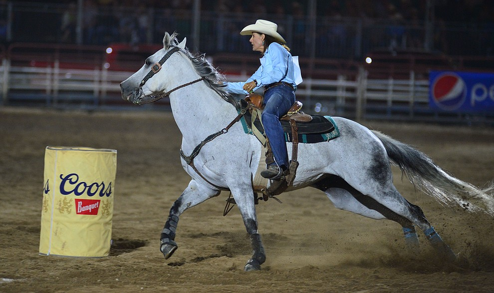 Laura Carmen makes a 18.10 second run in the barrel race during the third performance of the Prescott Frontier Days Rodeo Wednesday July 3, 2019.  (Les Stukenberg/Courier)