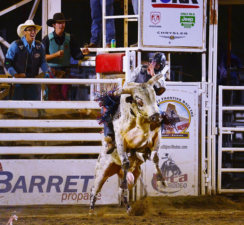 Wyatt Austin on Dances with Monsters in the bull riding during the third performance of the Prescott Frontier Days Rodeo Wednesday July 3, 2019.  (Les Stukenberg/Courier)