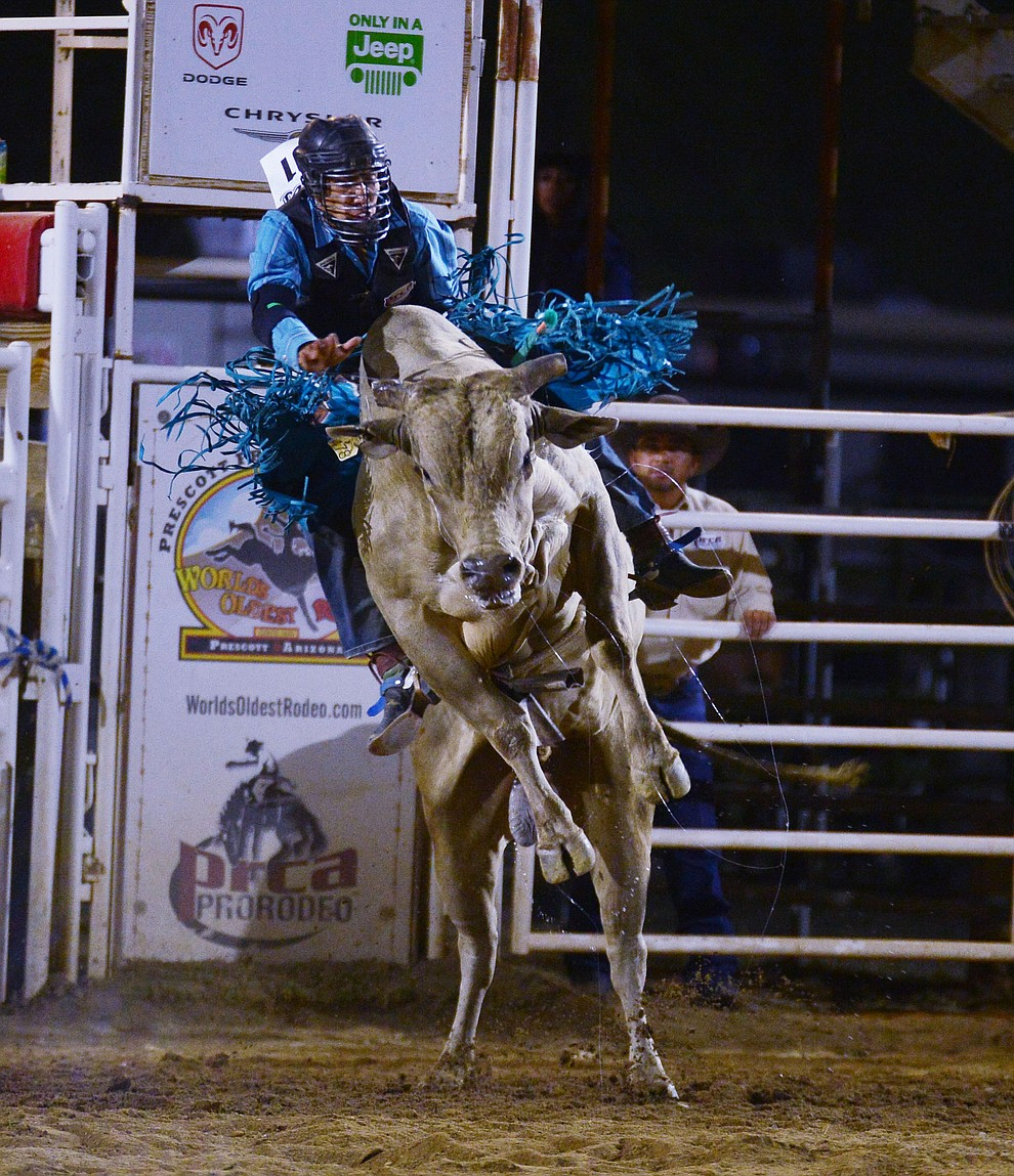 Wyatt Nez on Crazy Nights in the bull riding during the third performance of the Prescott Frontier Days Rodeo Wednesday July 3, 2019.  (Les Stukenberg/Courier)