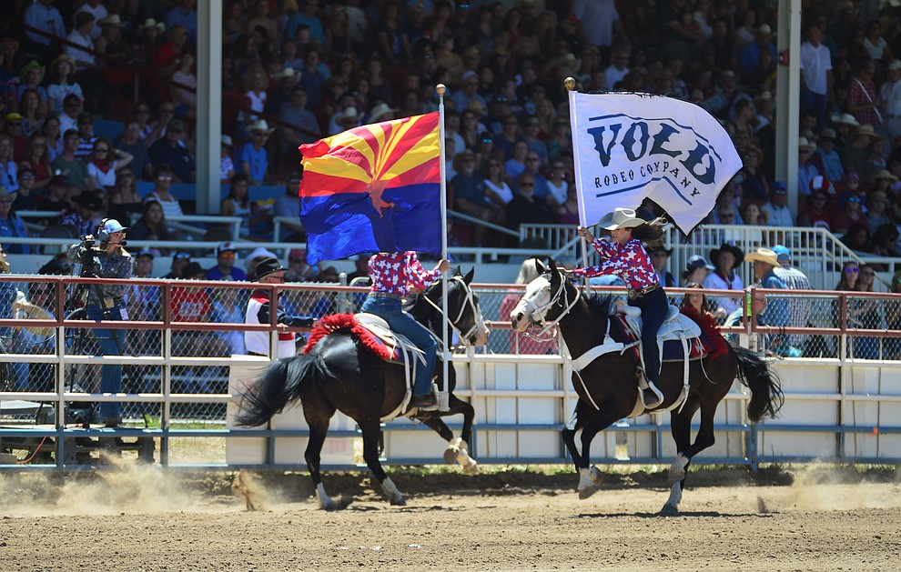 It was a star spangled grand entry during the fourth performance of the Prescott Frontier Days Rodeo Thursday July 4, 2019.  (Les Stukenberg/Courier)