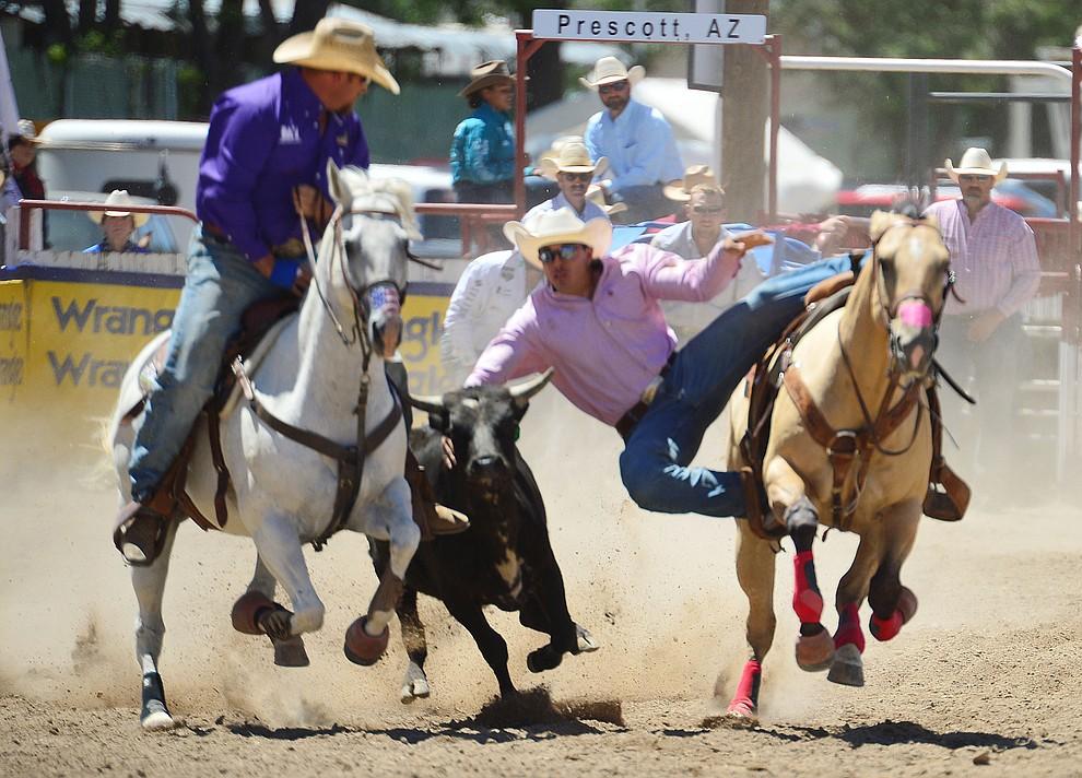 Dirk Tavenner in the steer wrestling during the fourth performance of the Prescott Frontier Days Rodeo Thursday July 4, 2019.  (Les Stukenberg/Courier)
