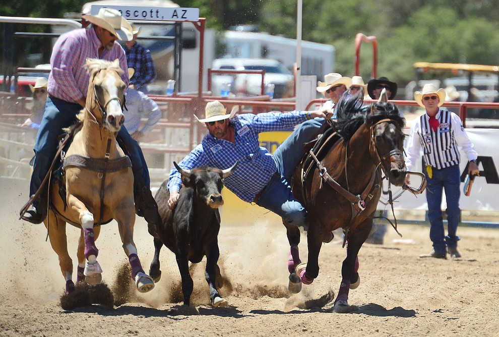 Dean McIntyre in the steer wrestling during the fourth performance of the Prescott Frontier Days Rodeo Thursday July 4, 2019.  (Les Stukenberg/Courier)