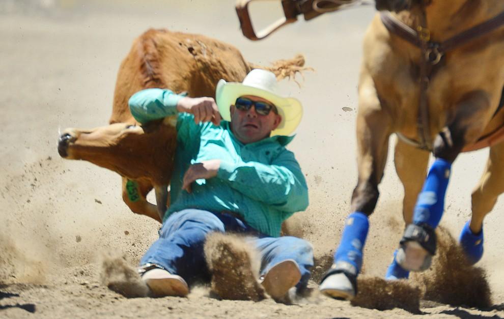 Clayton Tuchscherer in the steer wrestling during the fourth performance of the Prescott Frontier Days Rodeo Thursday July 4, 2019.  (Les Stukenberg/Courier)