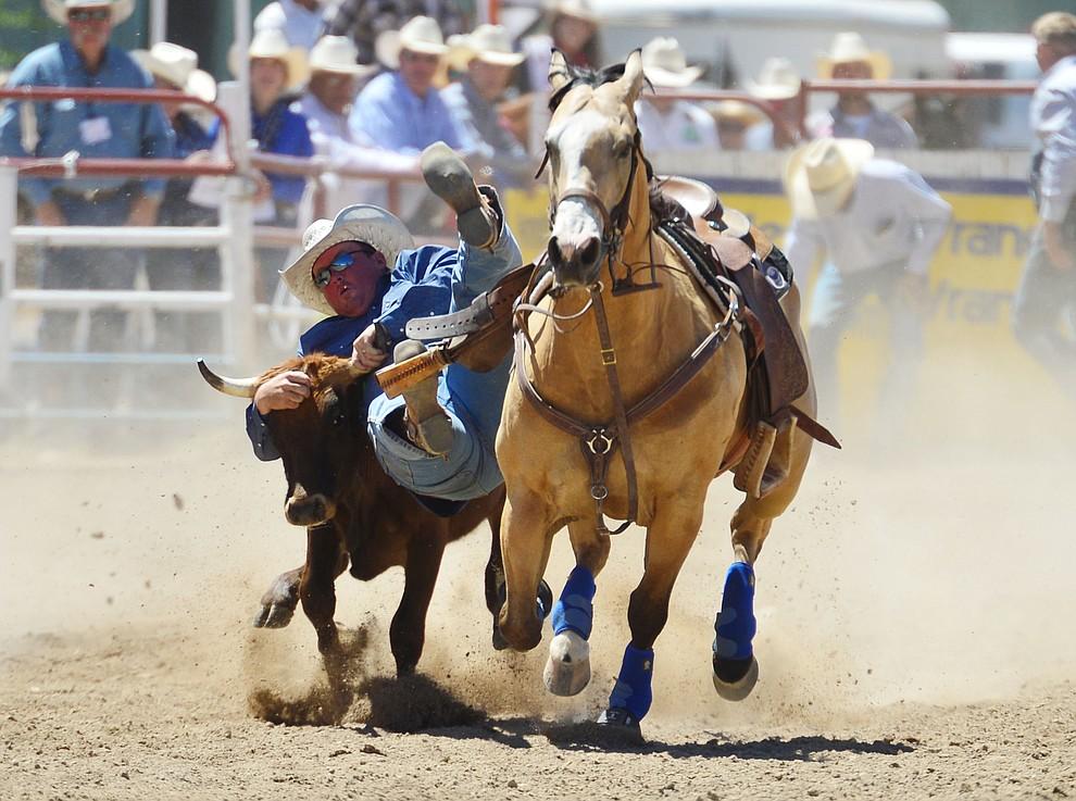 Monty Eakin in the steer wrestling during the fourth performance of the Prescott Frontier Days Rodeo Thursday July 4, 2019.  (Les Stukenberg/Courier)