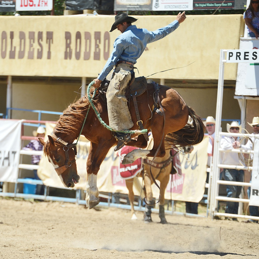 Logan Westcott in the Cowpunchers Bronc Riding during the fourth performance of the Prescott Frontier Days Rodeo Thursday July 4, 2019.  (Les Stukenberg/Courier)